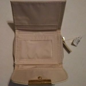 Icing Bags - NWT Cream multi pocket wallet